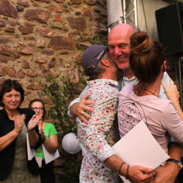 zotter hugs peggy & patrick after receiving his price